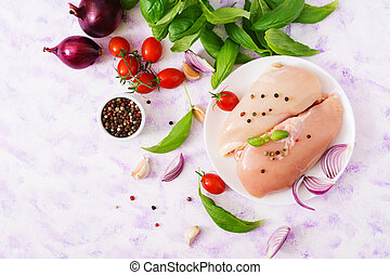 Raw chicken fillet prepared for baking in a plate. Top view