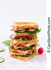Club sandwich with chicken breast, bacon, tomato, cucumber...