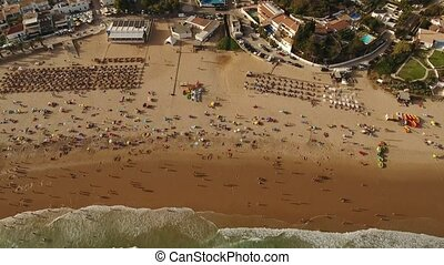 Aerial. Videography tourists on the beach Luz. Portual