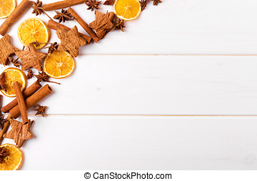 christmas background with spices on white wooden table with copy space