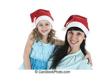 mother with a little daughter in Christmas caps on a white...