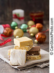 Christmas nougat and christmas decoration on wooden...