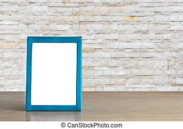 Empty blue brochure put on wooden table isolated on white...