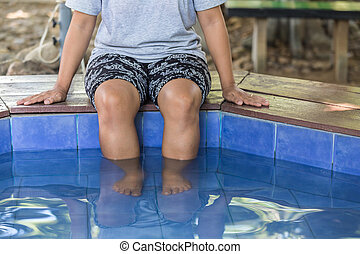 Nature spa, Legs of woman in hot springs pond, Mae hong son,...