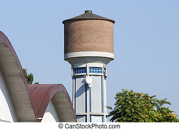 Tall Water tower with blue sky