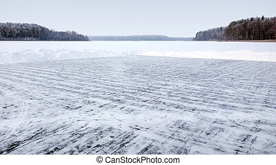 Skating rink on the ice of the frozen lake