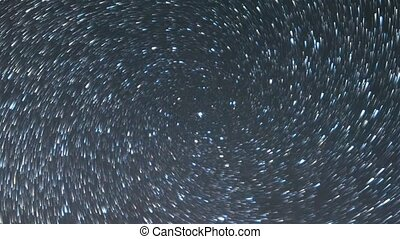 Stars like meteors in a spiral. Zoom. Time Lapse. Short tail