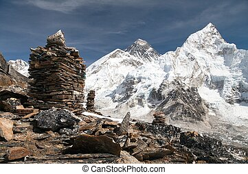 Everest and Nuptse from Kala Patthar with stone pyramids -...