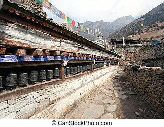 Buddhist prayer many wall with prayer wheels in nepalese...