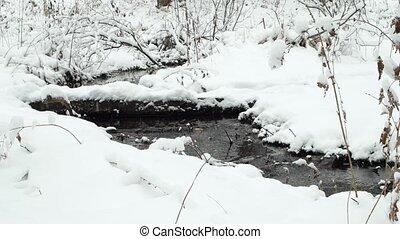 It runs through the snow stream. Russia. UltraHD (4K)