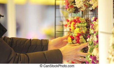 Woman interested in a folk wreath - Woman looking and...