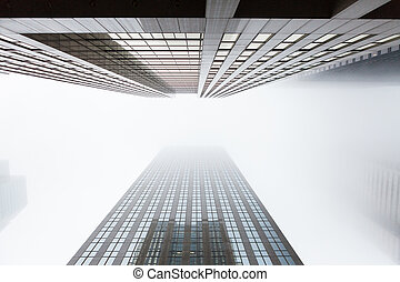 Looking up two highrise skyscapers in Toronto, Canada