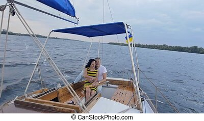 Beautiful couple of lovers sailing on a boat