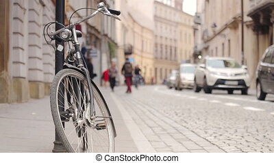 Urban traffic - pedestrians, cars and bicycle on historic street