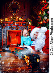 christmastime - Good old Santa Claus playing with a child...