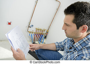 Man looking at wiring instructions