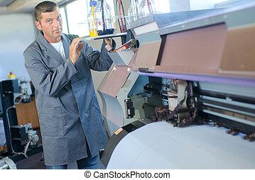 Man using printing machine