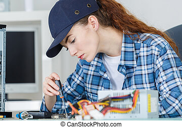 Female computer technician at work