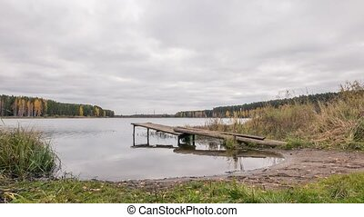 Wooden pier on the lake. Autumn landscape. Russia, Time Lapse