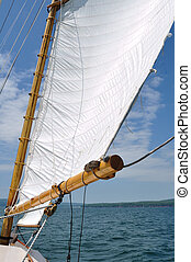 Foresail and Wooden Mast of Schooner Sailboat on a Sunny...