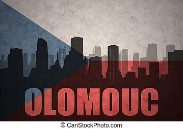 abstract silhouette of the city with text Olomouc at the...