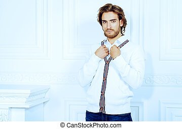 white cardigan - Attractive young man wearing white cardigan...