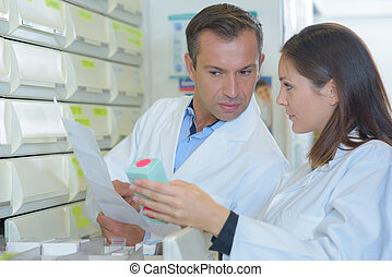 Dispensing pharmacists in discussion