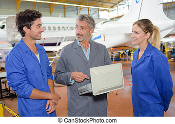 Aviation apprentices with tutor