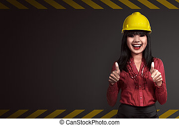 Asian people wearing yellow helmet. Labor day concept