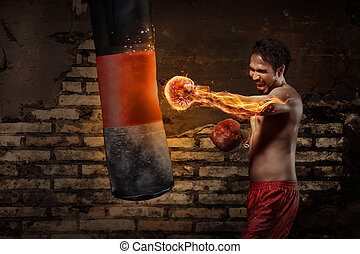 Powerful asian boxer man training with punching bag