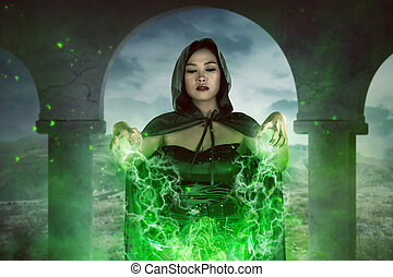 Asian witch woman spelling with concentration - Asian witch...