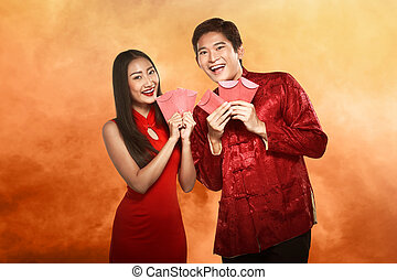 Asian couple in cheongsam suit. Happy chinese new year...