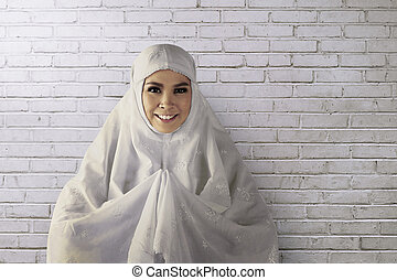 Young asian muslim woman wearing hijab give smile face, fun...