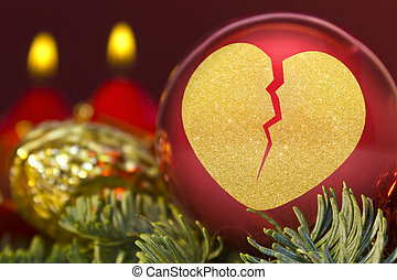 Red bauble with the golden shape of a broken heart. (series)