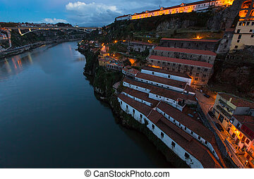Night view on the bank of the Dora river, Porto, Portugal.