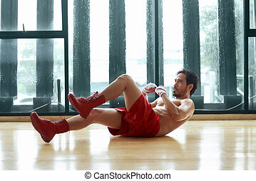 Fitness asian man doing exercise sit up lying in the floor
