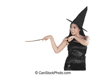 Beautiful young witch pointing and conjure something...