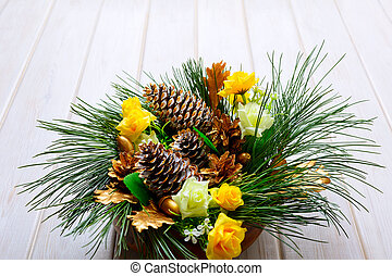 Christmas table centerpiece with golden pine cones and fir branches