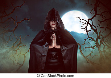 Asian witch woman casting spell in the night, with moon and...