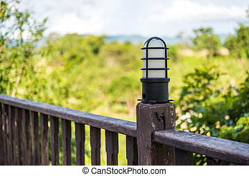 lamp on Wooden guardrail at the outside