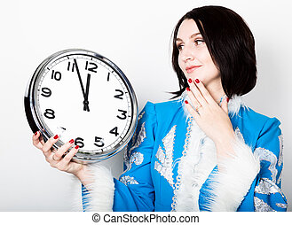 woman in christmas uniform holding a clock