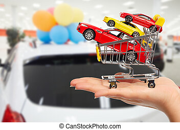 Dealer hand with a cars - Dealer hand with a toy cars. Auto...