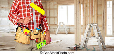 Builder handyman with paint roller. - Builder handyman with...