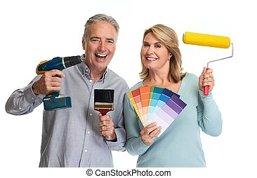 Senior couple with tools.