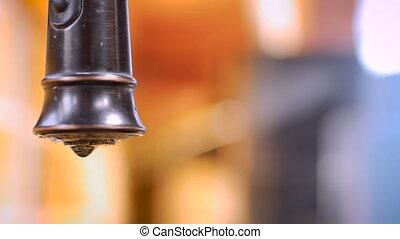 Extreme close up of a leaky faucet dripping water - ROOM FOR TEXT