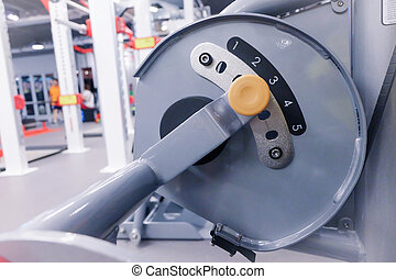 weight stack in sport club or gym and fitness room.