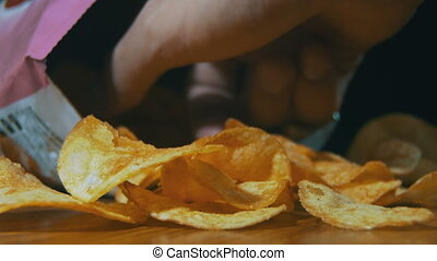 Potato Chips In Package Rotating. Open package of potato...