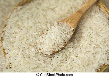 Thai jasmine rice on wooden spoon
