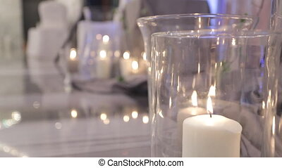 Romantic atmosphere created by candles, steles and silk.
