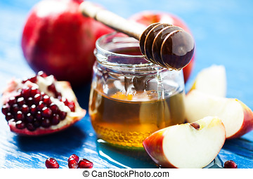 Rosh hashanah (jewish holiday) concept: honey, apple and...